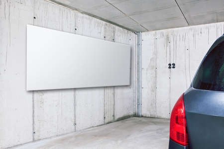 Blank white advertisement board on the wall in public parking area space Stock Photo - 23202438