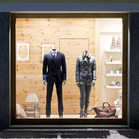 Stylish casual clothing in store at display window, winter collection