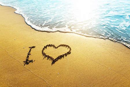 Love concept - inscription I love ... on a beach sand Stock Photo
