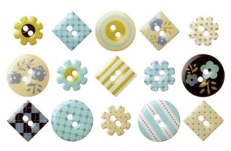 Set of various trendy sewing buttons isolated over white background photo