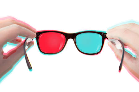 bicolor: Putting Your 3D glasses on (isolated over white background) Stock Photo