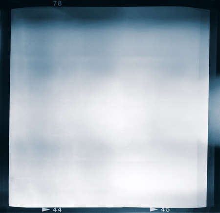 Blank medium format  6x6  color film frame with abstract filling containing lightleak in center, kind of a background