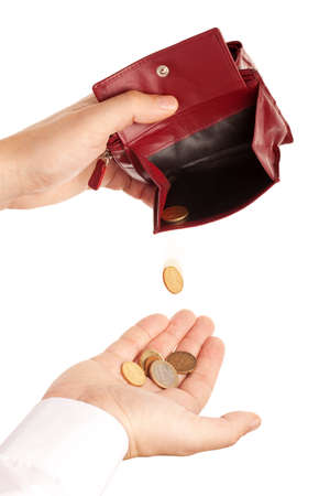 coin purse: Concept of lack of money - few coins falling of open wallet in a hand, isolated over white background Stock Photo