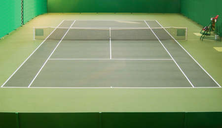 Empty green indoor tennis court Stock Photo