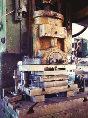 An old factory interior and an obsolete heavy machinery for metal works  Stock Photo - 12246401