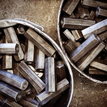 Grungy hexagon metal details in buckets photo