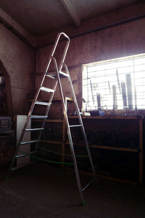 Ladder in a workshop or small old factory interior