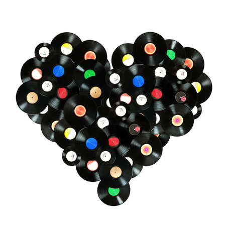 Concept  We Love Music  - colorful heart shape made of vintage vinyl records, isolated over white background, all labels are not real  designed by myself