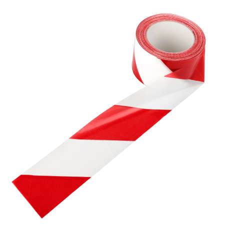 The spool of red and white caution or restriction plastic tape isolated over white background photo