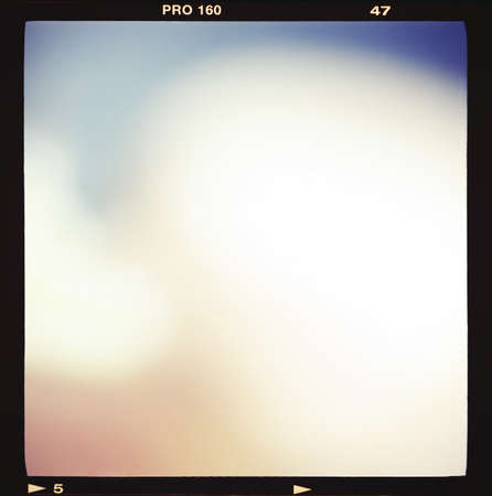 Blank medium format (6x6) color film frame with abstract filling containing light leak, kind of a background photo