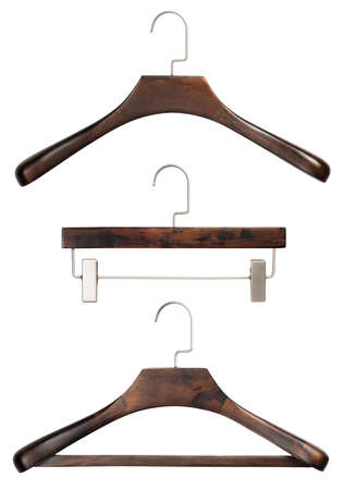 Closeup set of various luxury brown wooden clothing hangers isolated over white background photo