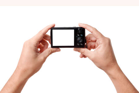 Hands holding compact digital photo camera with copy space for your image, isolated over white background photo