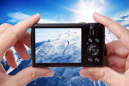 compact: Amateur photographer taking photo odfskiers Stock Photo