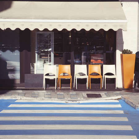 restaurant exterior: Generic Italian street cafe and pedestrian crossing