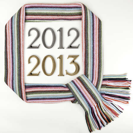 Funny Christmas frame made of warm scarf and numbers 2012 - 2013, New Year photo
