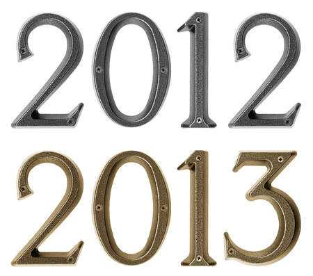 New year 2013 is coming concept - metal numbers 2012 and 2013, isolated over white background photo