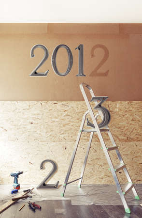renewed: The New Year is coming concept - numbers 2013 instead of 2012 on the wall in renewed room