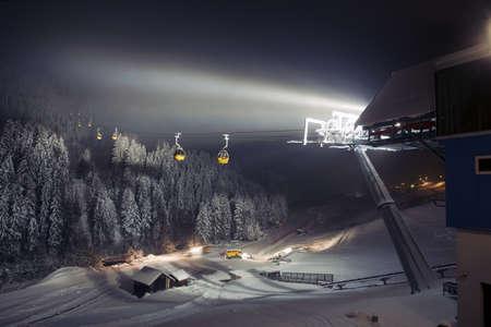 ski run: Ski lifts  gondolas  at night