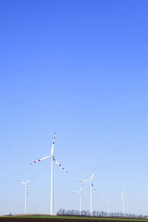 wind power plant: Power plant - wind farm - over clear blue sky  Stock Photo
