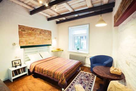 Bedroom - the interior of a cozy studio-type guest house Standard-Bild