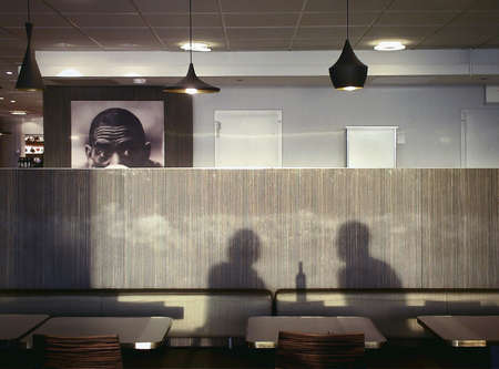 wish: Silhouette of a couple in a restaurant