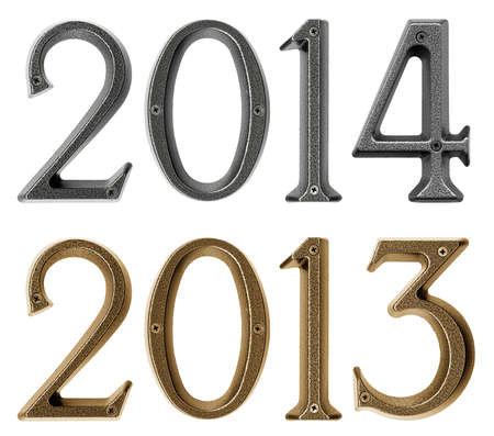 New year 2013 is coming concept - metal numbers 2012 and 2013, isolated over white background Stock Photo - 24698243