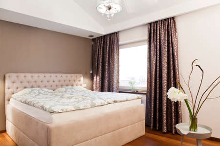 double bed: Cozy family bedroom interior - double bed and window
