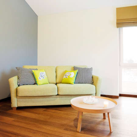 balcony window:  Interior detail - sofa and small table in a bright room  Stock Photo