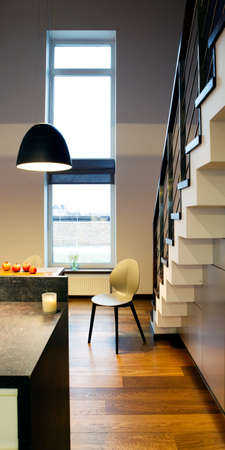 modern kitchen domestic home house: Interior design - chair in a kitchen and stairs Stock Photo