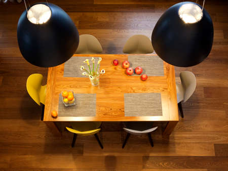Interior design - dinning table, big bowl lamps and chairs in a kitchen
