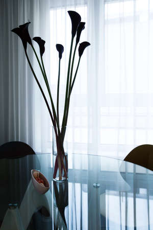 glass table: Detail of modern interior - glass table and flowers