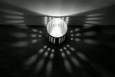 cilinder: Light bulb in a metal cilinder  casting beautiful shadow in black and white Stock Photo