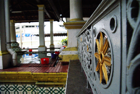 sight seeing: Inside view of an old mosque in Malacca Town area of muslim taking ablution water Editorial