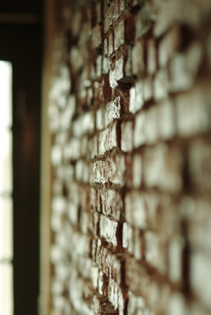 red brick repetition: Brick wall with shallow depth focus Stock Photo