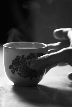 chinese tea cup: Hand holding a traditional Chinese tea cup