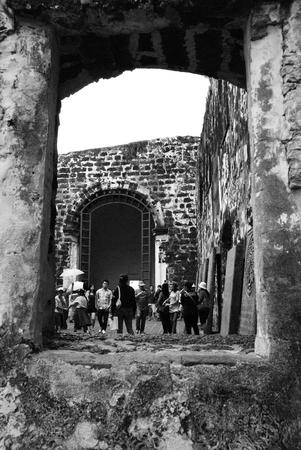Group of tourist at historical A Famosa fortress Malacca, Malaysia