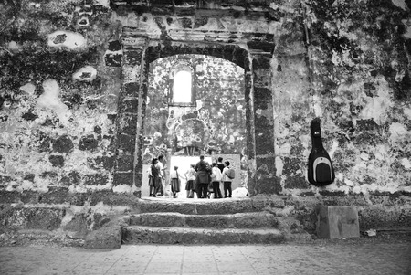 Group of tourist at historical A Famosa fortress Malacca, Malaysia