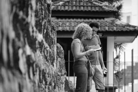 Two tourist reading map at historical A Famosa fortress Malacca, Malaysia