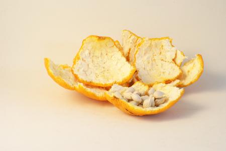 Mandarin orange peels and seeds on white Stock Photo