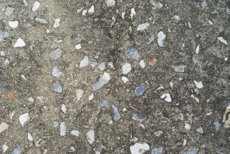 Rough asphalt and small stone road surface
