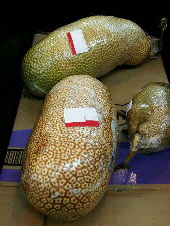 Wrapped cempedak fruits for retail at the market