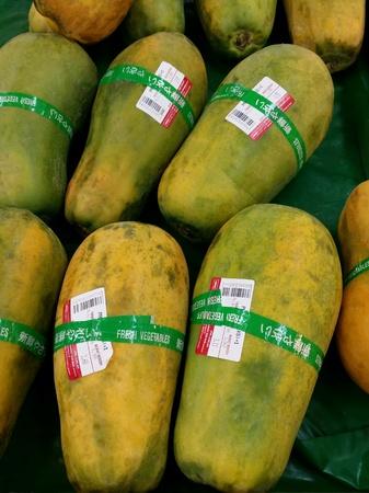 Fresh ripe papayas for retail at the market