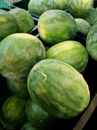 Ripe watermelons piled for retail at the market Stock Photo