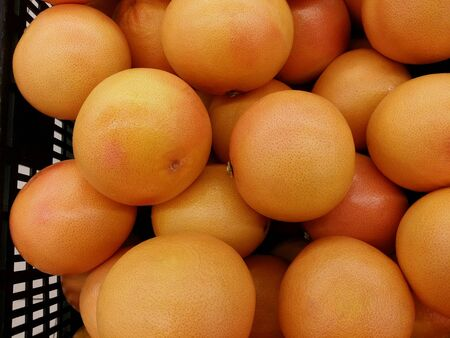 Grapefruit piled for retail at the market