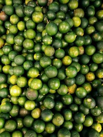 Fresh calamondin or limau kasturi piled for retail at the market