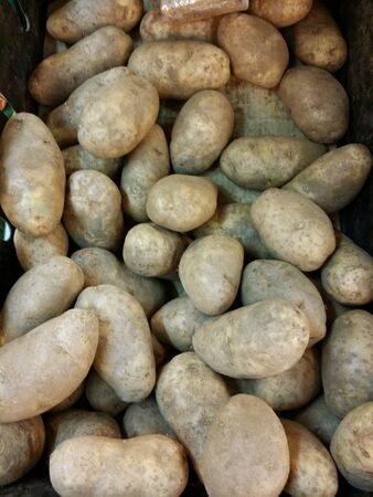 Potatoes piled for retail at the market Stock Photo