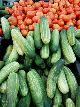 Mediterranean cucumber and fresh tomatoes piled for retail at the market Stock Photo - 24701164