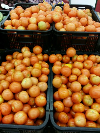 Fresh tomatoes piled for retail at the market