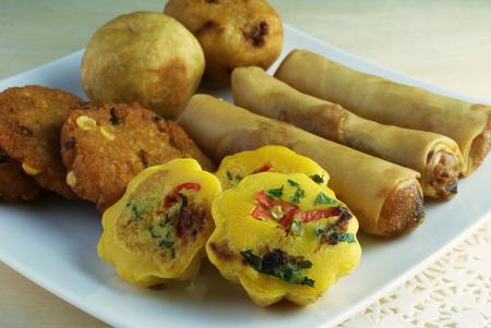flavoursome: Assorted Malay traditional food - Kuih Cara Berlauk, Cucur Badak, Popiah, Vadeh - Focus on Kuih Cara Berlauk Stock Photo