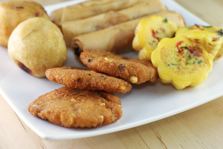 Assorted Malay traditional food - Kuih Cara Berlauk, Cucur Badak, Popiah, Vadeh - Focus on Vadeh photo